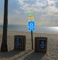 recycling bins on beach