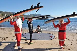 surfing santa elf.image