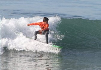 Dukes' son surfing