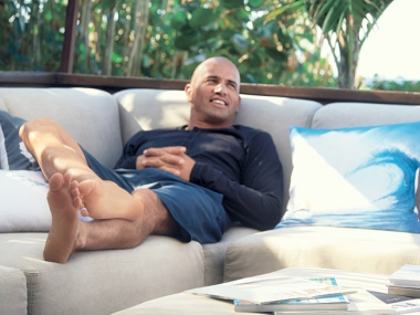 Kelly-Slater lying on sofa