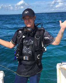 wyland-on-boat-diving